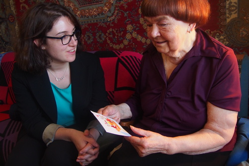 Beth saffer handing a rosh hashanah card from a supporter to an older woman in kiev  ukraine listing