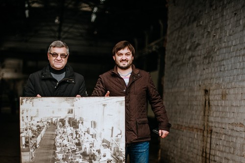 Vardan with his father and the photograph of the factory in its heyday listing