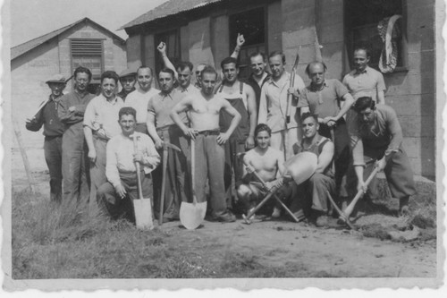Kitchener camp men with spades listing