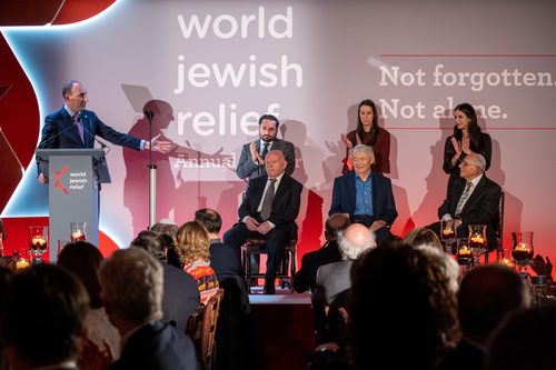 Dan rosenfield on stage with the boys and members of the young world jewish relief committee 2 listing